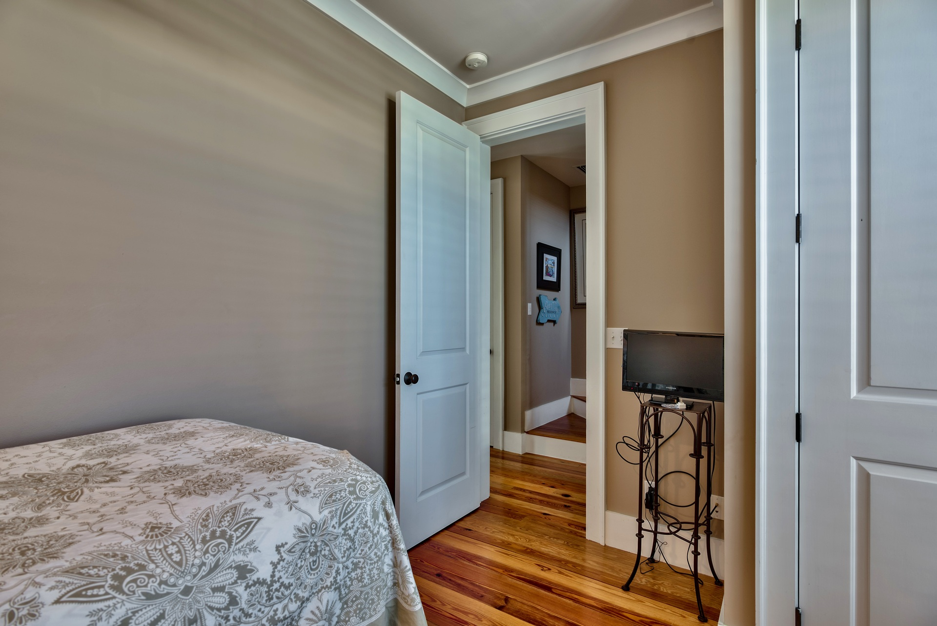 Twin room entrance with tv